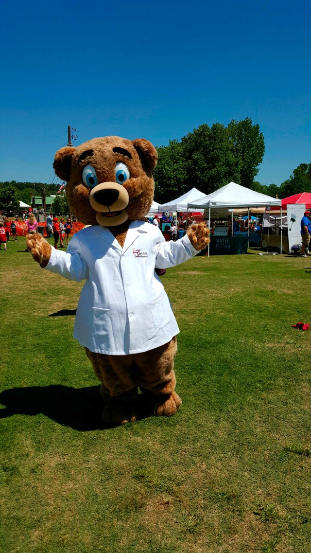 The Carroll Pharmacy Caring Bear mascot